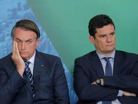 Presidente Jair Bolsonaro ao lado do ex-ministro da Justiça, Sergio Moro, durante evento em Brasília 18/12/2019 REUTERS/Adriano Machado